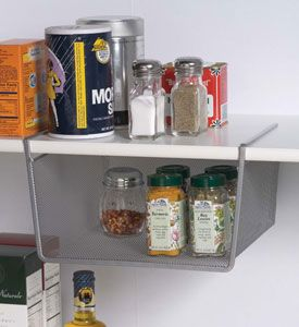 Utilize the unused storage space in any cabinet or closet with a Small Silver Mesh Under Shelf Storage Basket.  This cool cabinet shelf organizer simply slides onto a shelf measuring up to 1inch thick and provides a mesh storage basket great for organizing extra spice jars sandwich bags coffee mugs canned goods and mor