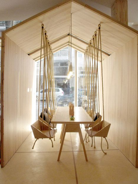 This cafe features wooden swing seats for both adults and children.