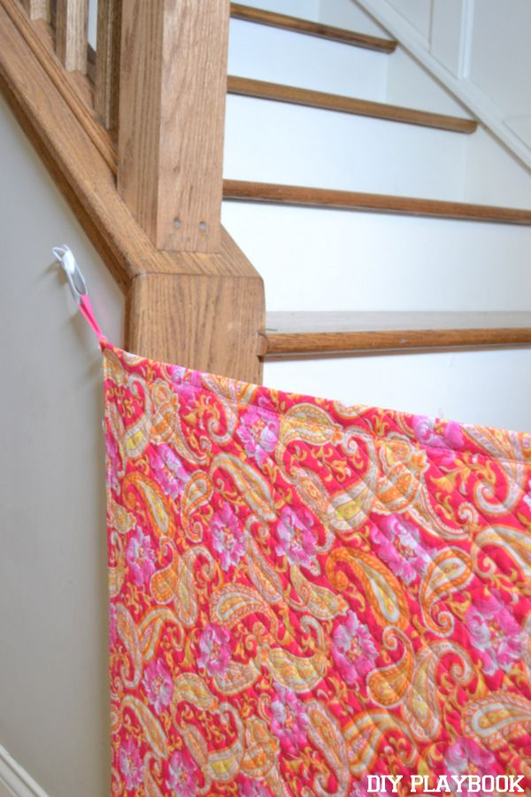 If you have uneven stairs, create this colorful fabric gate to keep your kids or pets from going up them!