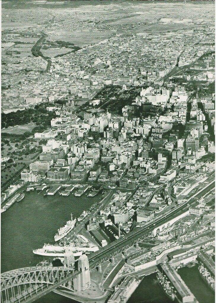 Aerial view of Sydney looking toward southeast.Shows Circular Quay and Hyde Park c.a. 1933/34,a year or two after the Sydney Harbour Bridge was built.