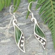 G2368+-+NZ+Jade+Silver+Earring    Elegant,+slightly+domed,+drop+earrings.  Length+31+mm,+++++Width+9+mm  NZ+Greenstone+inlaid+in+Sterling+Silver.+A+design+that+speaks+of+the+mountains,+the+bush+and+the+sea,+but+with+elegance+and+sophistication.    Meaning:  Roimata+/+Kuru+/+The+Drop  Encourages+k...