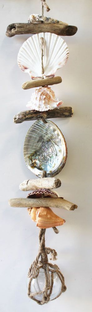 Hand-crafted Nautical Garland with Clear Glass Float  (http://www.caseashells.com/nautical-float-garland-clear/)