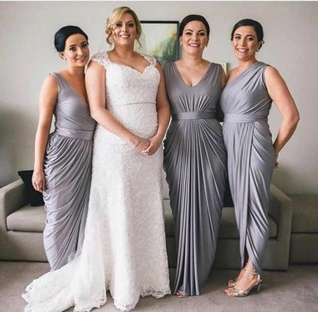 Pia Gladys Perey Bridesmaids Dresses. The iron colour looks amazing with this beautiful bride and the draping on the dresses so elegant and perfect to hide areas you want hidden. Now available at Nora and Elle Bridesmaids.