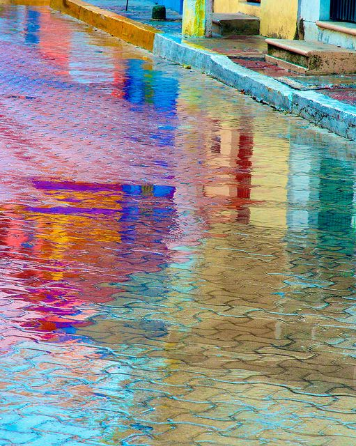 Island Color Reflection in the Street    With all the rain here in Isla Mujeres over the past few days (Tropical Storm Alex), reflections in puddles have become favorite subjects. On this island bold color is everywhere! (EXPLORE - June 28, 2010)    Taken with Nikon D300 and Nikkor 85mm f1.4 @ f13 and a circular polarizing filter. (I also added saturation and vibrancy in Aperture.)