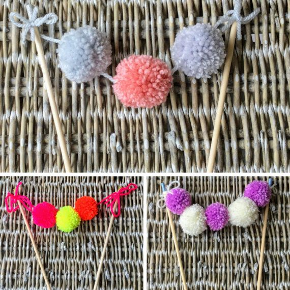 Pom pom cake toppers in a variety of colours Custom orders