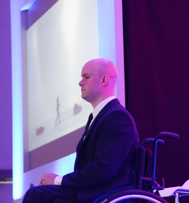 Mark Pollock as guest speaker at a conference in O'Reilly Hall