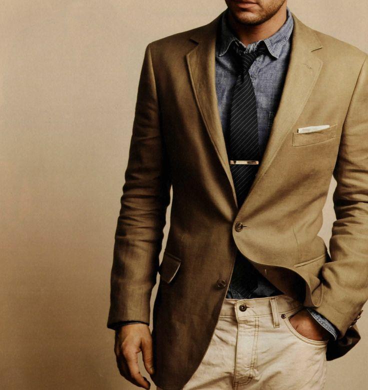 Beige blazer. Denim shirt. Tie. Tie Pin. Pocket square. Trousers.