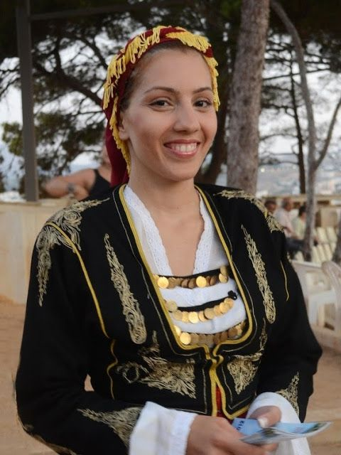 Cretan girl in traditional costume.