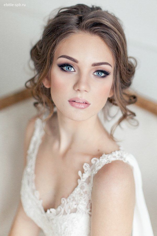 **I like how clean and fresh her skin looks and how defined her eyes are but I'm worried about wearing that black of a smoky eye during my afternoon ceremony. I don't want to look like I have tons of makeup on. The lip is perfect.