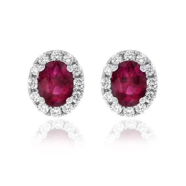 Dazzling Aura earrings featuring a matched pair of oval rubies surrounded by white diamonds. The Gerard McCabe Aura range features matching earrings, pendants and rings. These earrings are crafted in 18ct white gold and are secured with butterfly clasps.