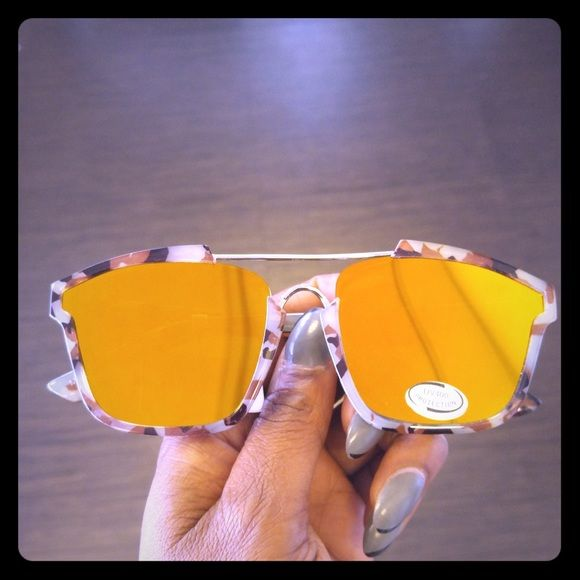 Orange mirrored sunglasses with a tan frame A awesome pair of sunglasses that has an orange mirrored lens. Get them before they're gone Accessories Sunglasses
