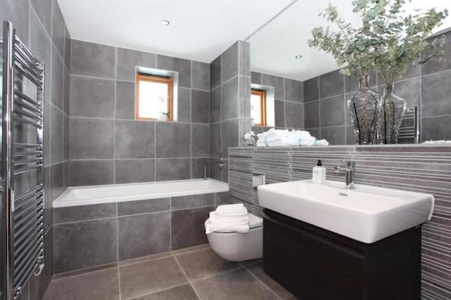 Grey bathroom - add some pops of color with towels/ soaps/ flowers/ etc. I love the simplicity and clean lines.