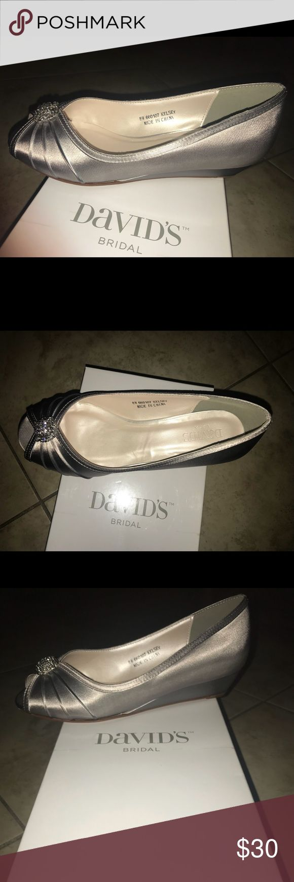 Silver Shoes Silver davids bridal size 8W brand new. They did not fit my mom and it is non-refundable & non-exchangeable. David's Bridal Shoes Wedges
