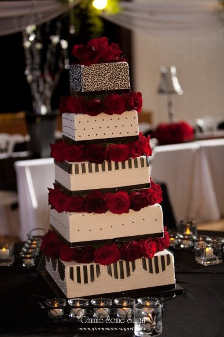 large tiered black white and red wedding cake with rose blocking and stripes www
