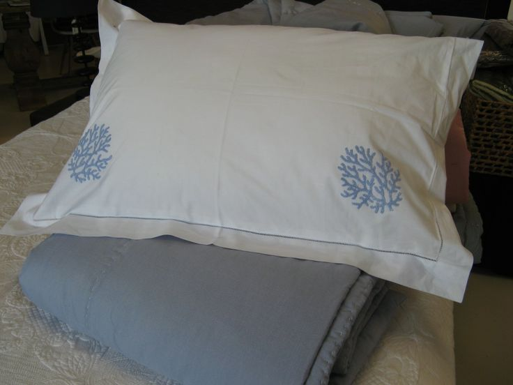 Her Shed Blue Coral Pillowslips $129.00 100% cotton pillowslips with elegant blue coral embroidered detail.  Measures 50 x 70cm.  Includes two pillowslips.