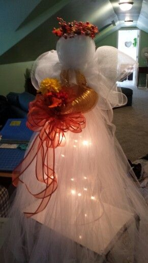 Angel using tulle, tomato cage, and deco mesh