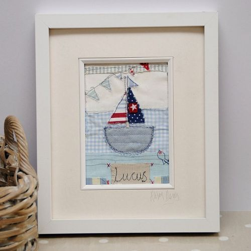 Personalised embroidered wall art for a boy's room.