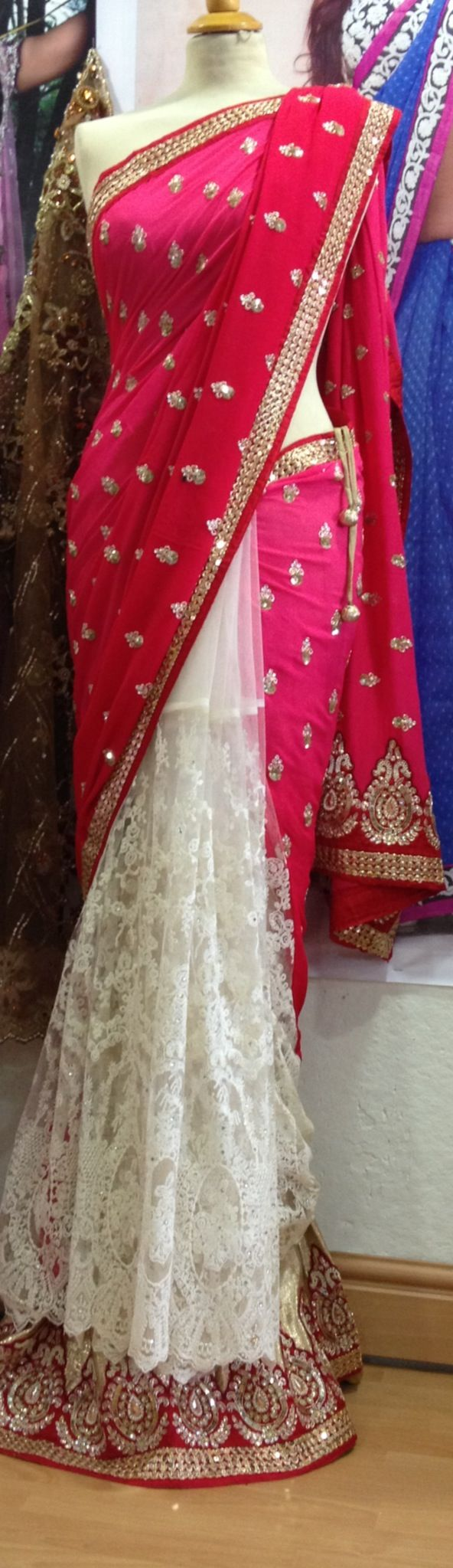 Net pleats saree. Subtle white and loud pink. Love the contrast. Get this in your own colors on www.faaya.in