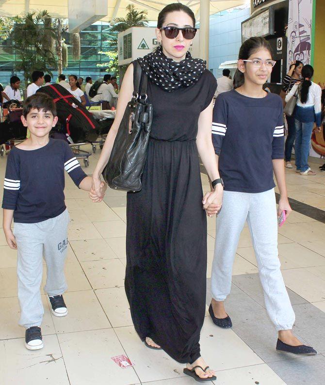 Karisma Kapoor with her children Kiaan Raj Kapoor and Samaira Kapoor at Mumbai airport. #Bollywood #Fashion #Style #Beauty