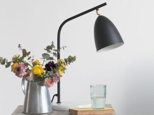With its black matte finish, simple marble base and smart brass details, this monochrome floor lamp is an absolute design classic. What's not to love?