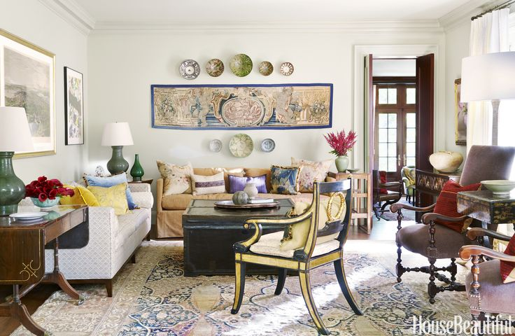 SEATING ZONES In a home near Washington, D.C., designer Mona Hajj took inspiration for the living room's palette from the colors of a 19th-century Persian Tabriz rug. A skirted sofa by Gérard and a sofa with wooden legs from A. Saved from:http://www.housebeautiful.com/room-decorating/living-family-rooms/g715/designer-living-rooms/?slide=13