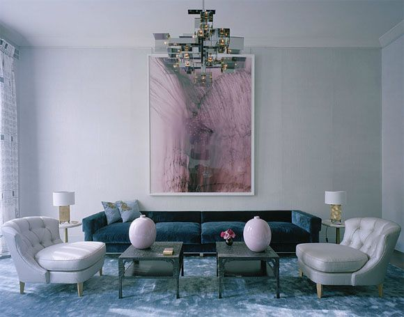 Deep Prussian blue, a watery blue, and a silvery grey create a subtly moody palette for this modern, sophisticated, and carefully edited living room. Interior Designer: David Collins.