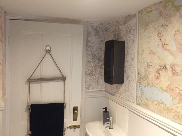 Mountain Maps on the walls in the cloakroom.