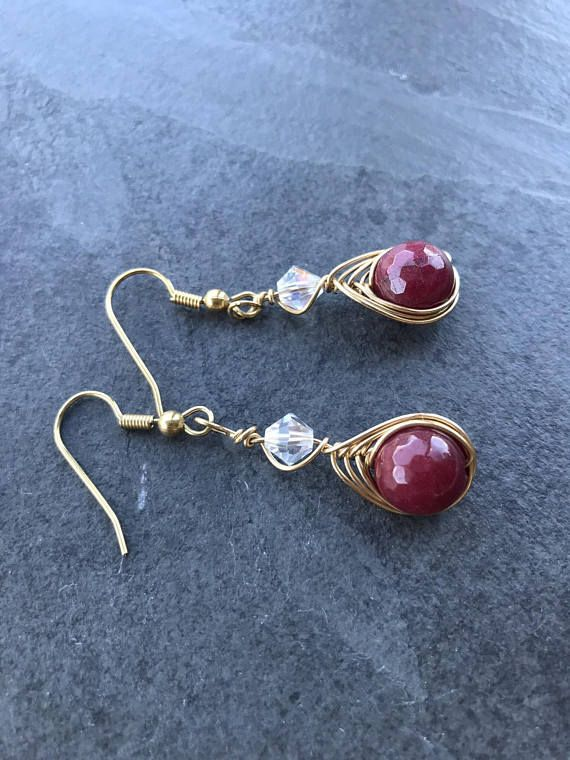 Red agate earrings, stud red earrings, dangle red agate earrings, red agate Swarovski wire wrapped earrings Amazing wire wrapping red agate earrings make using a wire wrapped techinque. Material: - red agate - gold wire - gold hook Measure: 1.5 inch