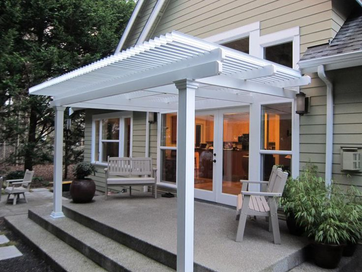 Small Louvered Roof Patio Cover Attached To The House Over A Stepped Patio