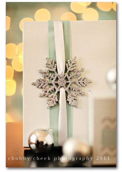 glitter snowflake gift wrapping, I saw a pack of glitter snowflakes at the dollar store that would work perfectly for this!