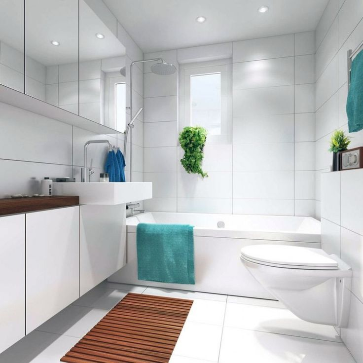 upper cabinets to save space  white tiles make the space appear larger  easy clean surfaces