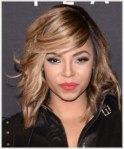 Ashanti with blonde hair dark roots
