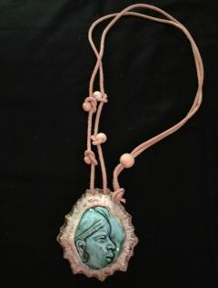 Limpet shell with porcelaine glaze and adjustable leather thong medallion with wooden bead detai