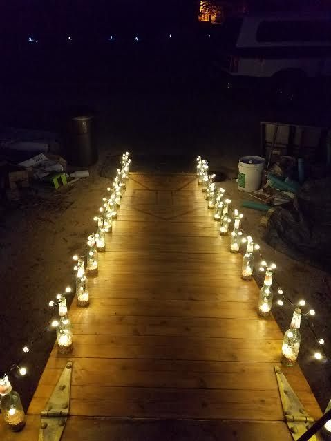 A woman buys Dollar Store glass bottles. Her walkway idea? This is SO stunning!
