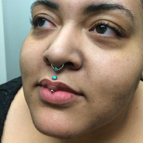 Here is a healed septum and freshly downsized/healing vertical philtrum sporting mint green and turquoise. This gal rocks the hell out of this combo! #saintsabrinas #safepiercing #appmember #anatometal #septum #lippiercing #piercing #turquoise  (at Saint Sabrina's)