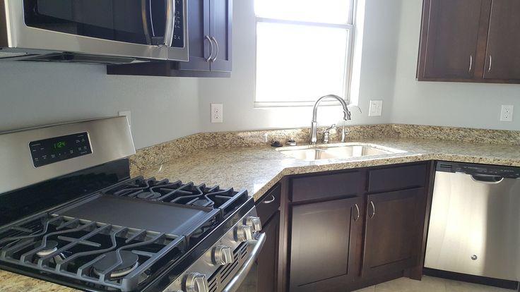Erminia Plan: Stainless gas range, OTR microwave, undermount stainless double bowl sink, satin nickel Delta faucet