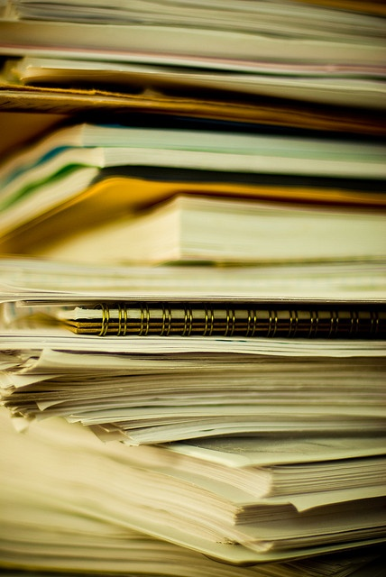 It's about time to develop a better way to organize the papers on my desk.     Is your work space hurting you?