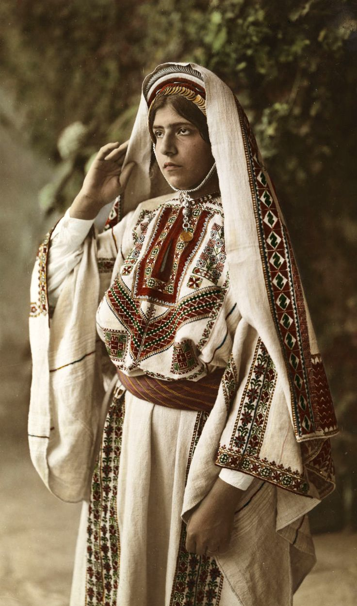 Palestine | 'A bride wears traditional costume with embroidered cloth and a veil'. 1910s | ©American Colony Photographers / National Geographic Creative