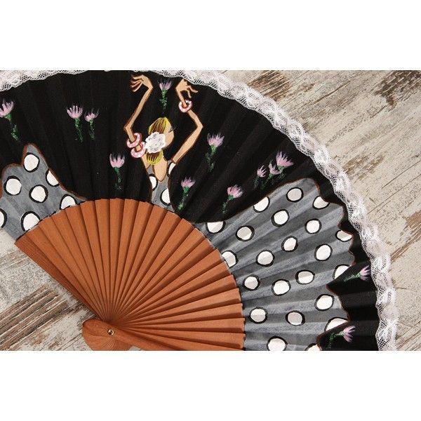 """Para sofocar el calor de la feria y del verano, recomendamos el Abanico Mujer Flamenca nº 13, con vestido gris de lunares blancos bordeados en negro. Palillería en madera y tela negra pintado a mano, con puntilla de encaje blanco bordeando el exterior. """"Las Marielitas"""" presentan en su colección """"27 lunares"""" a unas flamencas estilosas, elegantes y con mucho arte. Son diseños exclusivos y únicos: en los producto artesanales, no hay nunca dos iguales."""
