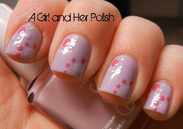 Pink and purple dotting. Such a fun and cute nail style idea! Visit Beauty.com for more.