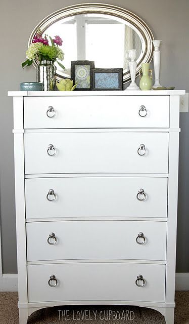 like the idea of an oval mirror above a chest of drawers