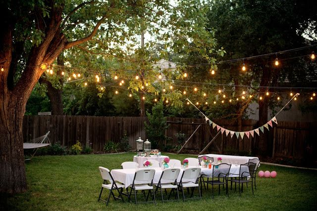 Lighting ideas for backyard entertaining + love the pendant flags and centerpieces