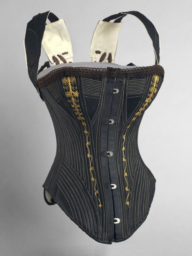 1890 Woman's Corset and Shoulder Braces,Black and off-white cotton sateen, brown cotton lace, brown cotton twill, yellow silk thread, black and brown cotton/elastic. Probably Made by Williamson Corset and Brace Co., Saint Louis. Philadelphia Museum of Art, USA.