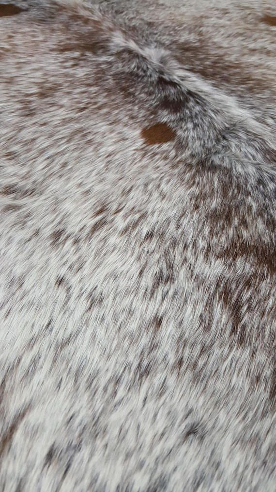 You Will Receive The Exact Brazilian Cowhide Rug As Shown In The Image. Size is 70 by 60 inches. Beautiful and Unique Salt Pepper Mostly White With Reddish Brown Spots Cow Hide. All our cowhide rugs are hand picked from Brazil and individually selected for its unique and exotic pattern. Each Cow Rug Is hand finished and Chromium Tanned, making very soft and smooth. The best part about these soft hides is that, these do not get any wrinkles or folds, you can even take it for camping. Free of…
