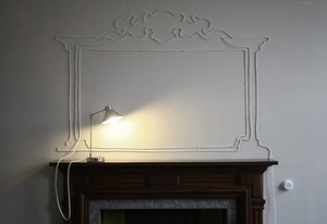 Making use of ugly cords. How clever is this?