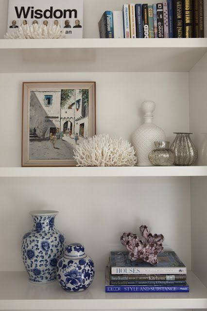 Coral and conch shells placed in bookshelves is a nice look; even if the house is not a beach house, or beach themed decor.