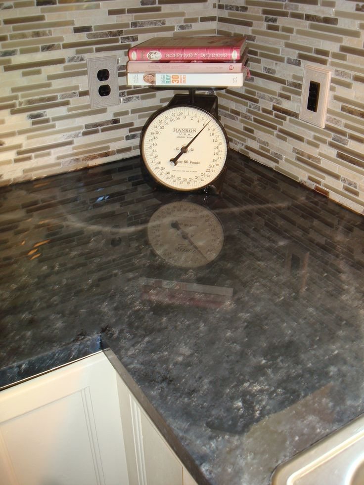 My shiny, glossy painted laminate countertops use Envirotex Lite for high gloss. Found at Hobby Lobby