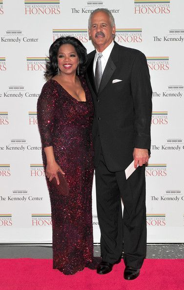 Oprah Winfrey, one of the 2010 Kennedy Center honorees, arrives with Stedman Graham for the formal artist's dinner for the Kennedy Center Honors at the United States Department of State December 4, 2010 in Washington, D.C.