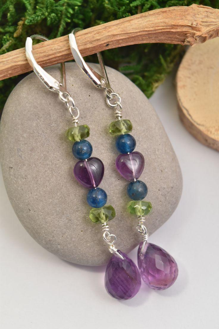 Amethyst Purple Heart, Peridot, Apatite Dangle Earrings in Green & Purple with Multi Gemstones.  These Earrings Carry the Intention of Loosening the Grip of Ones Ego and Allowing One to Hear the Language of the Heart – May it Lead You on a Beautiful Journey. Handmade with Natural Gems & Crystals and Expertly Finished in Sterling Silver by: Love, Ludwiga - you can visit the shop: https://www.etsy.com/ca/shop/LoveLudwiga  #loveludwiga