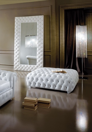 Diva Collection seductive foot stool. Shown here upholstered in white leather with a button finish.